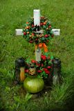 Cross with a wreath and candles, a tomb stock photo