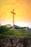 Cross on yellow sunrise sky Royalty Free Stock Photography