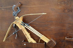 Crossbow. A leaf wooden crossbow and arrows Royalty Free Stock Image