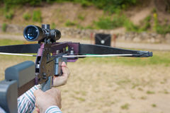 Crossbow. Man targeting with a scoped crossbow Stock Images