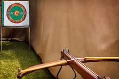Crossbow is ready for a shot aimed at the target. Toned Royalty Free Stock Photos
