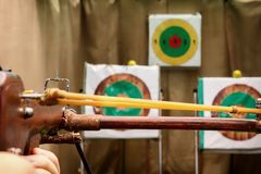 Crossbow is ready for a shot aimed at the target. Toned Royalty Free Stock Images