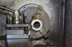 Crosscutting parts on a lathe Stock Images