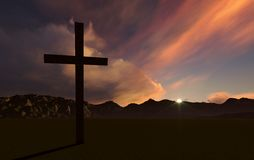 Crosse at Sunset. Dramatic sky silhouettes three wooden crosses with shafts of sunlight breaking through the clouds Royalty Free Stock Images