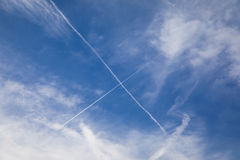 Crossed Airplane Trails Stock Images