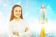 Crossed arms businesswoman, startup rocket toned Royalty Free Stock Images