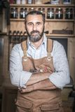 Portrait of caucasian carpenter in workshop Royalty Free Stock Images