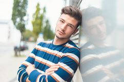 Crossed arms portrait of a beautiful young man royalty free stock photos