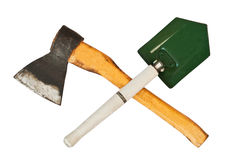 Crossed ax and entrenching shovel Royalty Free Stock Photo