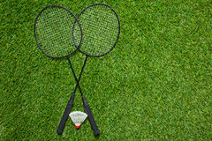 Crossed badminton rackets with shuttlecock Stock Images