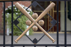 Crossed Baseball Bats. And balls emblem in wrought iron fence railing outside the National Baseball Hall of Fame, Cooperstown, NY Royalty Free Stock Photo