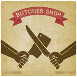 Crossed butcher knives old background Royalty Free Stock Image