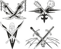 Crossed daggers, swords and maces Royalty Free Stock Photo