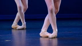Crossed feet of duo of ballerinas Stock Photography
