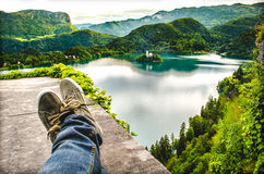 Crossed feet lake aerial bled slovenia relax travel.  Stock Image