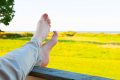 Crossed feet Stock Images