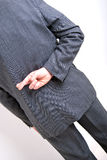 Crossed fingers. A conceptial image of a business man with his fingers crossed behind his back Royalty Free Stock Photo