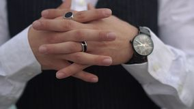 Crossed fingers close up of stylish man on the classical suit. Stylish watch on the hand of the big boss. Crossed fingers close up of stylish man on the stock video footage