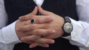 Crossed fingers close up of stylish man in a white shirt. Stylish watch on the hand of the big boss. Crossed fingers close up of stylish man on the classical stock video