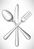Crossed fork, knife spoon Stock Image