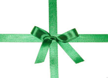 Crossed green ribbons with bow Stock Image