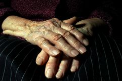 Crossed hands of an old woman Royalty Free Stock Photo