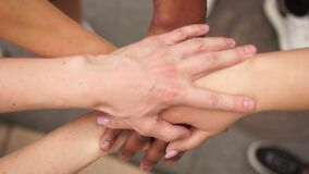 Crossed hands of people of different colors, multi-racial group of people, support and solidarity of the BLM movement