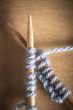 Crossed Knitting Needles Stock Images
