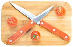 Free Crossed Knives On Chopping Board Stock Photography - 29368992