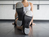 Crossed legs with Tap Shoes. Perspective of the bottom of a tapper`s tap shoes Royalty Free Stock Image