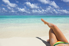 Crossed legs young girl on vacation Royalty Free Stock Photos