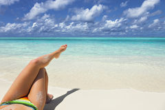 Crossed legs young girl on vacation Royalty Free Stock Images