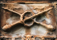 Crossed Maces - Detail on Tomb Royalty Free Stock Image