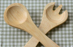 Crossed natural wooden salad fork and spoon Royalty Free Stock Photos