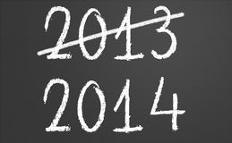 2013 crossed and new year 2014 on chalkboard. 2013 crossed and new year 2014 written on chalkboard Royalty Free Stock Images