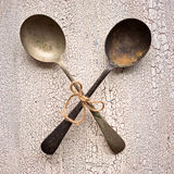 Crossed Old vintage spoons on white wooden background, top view Stock Photo