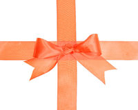 Crossed orange ribbons with bow Royalty Free Stock Images
