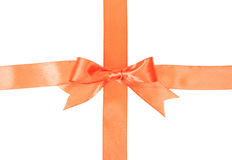 Crossed orange ribbons with bow Royalty Free Stock Photography