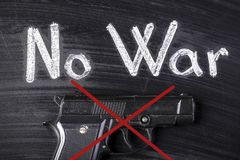 No war. Crossed out gun on the board near to the inscription there is no war stock photography