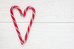 Crossed peppermint candy canes on white wooden background, copy space Royalty Free Stock Photo