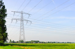 Crossed power lines in a Dutch rural landscape Royalty Free Stock Photography