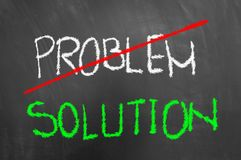 Crossed problem green solution text on chalkboard or blackboard Stock Photo