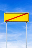 Crossed road sign over blue sky Royalty Free Stock Photos