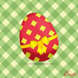 Crossed stripes Easter egg on green background with text Stock Images