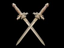 Crossed swords in the dark Royalty Free Stock Image