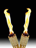 Crossed Tiki Torches Royalty Free Stock Photo