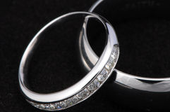 Crossed wedding rings royalty free stock photography