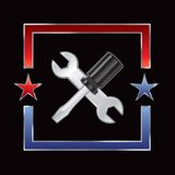 Crossed wrench and screwdriver in american frame Stock Images