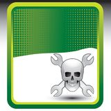 Crossed wrenches and skull on green halftone ad Royalty Free Stock Images