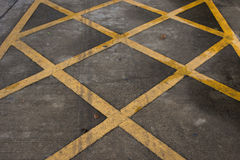 Crossed yellow lines Royalty Free Stock Photography